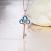 Picture of IDEAL 18K Gold Blue Topaz Key Pendant